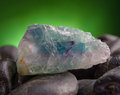 Fluorite also called fluorspar natural crystal on amethyst rock Stock Photo