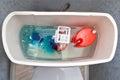 Flush mechanism inside cistern of toilet, blue water tablet diss
