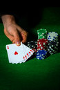 Flush in poker and betting chips on green cloth Royalty Free Stock Photo