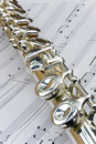 Flute lay across sheet music Royalty Free Stock Image