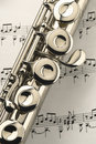 Flute on music sheet Royalty Free Stock Photography