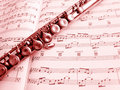 Flute musical instrument & score Royalty Free Stock Images