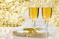 Fluted champagne and a present Royalty Free Stock Image
