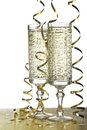 Flutes of champagne and streamer on holidays. Isolated Royalty Free Stock Photo