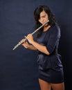Flutist female on blue background Stock Photo