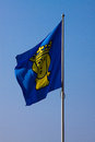 Fluttering flag with the coat of arms of stockholm against blue sky Royalty Free Stock Images