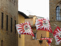 Fluttering flags in Volterra village during historic flag throwing competition . Tuscany, Italy Royalty Free Stock Photo
