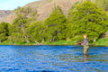 Fly fisherman deschutes river an experienced wades in the water while fishing the in oregon Stock Photo