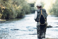 Fly fisherman using flyfishing rod. Royalty Free Stock Photo