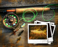 Fly fishing rod with pictures  Royalty Free Stock Image