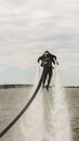 Flyboard aerobatics by jetski freestyle team during at aeronautic show morii lake bucharest Stock Image