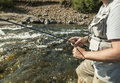Flyfisherman close up man fishing for salmon in a beautiful surrounding Royalty Free Stock Image