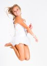 Flying angel blonde young woman in costume jumping on white background Royalty Free Stock Photos
