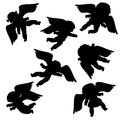 Flying angels silhouettes against white background Royalty Free Stock Images