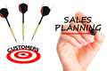 Flying arrows to a customers target suggesting sales planning Royalty Free Stock Photo