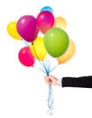 Flying balloons with businessman hand isolated on a white background Royalty Free Stock Photography