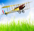Flying biplane over a airfield. Royalty Free Stock Photos