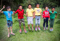Flying boys kathmandu nepal june nepalese are together with holding hands in the middle of the forest Royalty Free Stock Image
