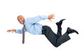 Flying businessman happy high isolated in white Royalty Free Stock Photo