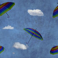 Flying colorful umbrellas on blue sky Royalty Free Stock Photo