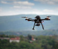 Flying drone with camera on the sky Royalty Free Stock Images