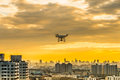 Flying Drone At Twilight