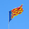 Flying flag of the valencian community senyera coronada Stock Photos