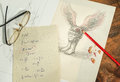 Flying head with a cup of coffee and a sheet with mathematical formulas glasses pencil on wooden table Stock Photography