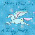 Flying horse year card christmas and new s greeting with over a blue background with dots and snowflakes Stock Images