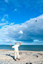 Flying a kite on the beach Royalty Free Stock Photos