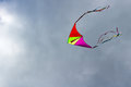 Flying kite on the cloudy blue sky background Royalty Free Stock Photo