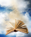 Flying opened magic book Royalty Free Stock Photo