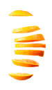 Flying orange slices Royalty Free Stock Photo