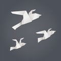 Flying paper birds three isolated on background Stock Image