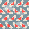 Flying in the sky with clouds brighy hearts with wings seamless pattern abstract background for valentines day or wedding Royalty Free Stock Photo