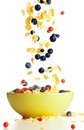 Flying to the bowl corn flakes with berries Royalty Free Stock Photo