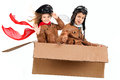 Flying young boy pilot and girl a cardboard box isolated in white Royalty Free Stock Images