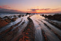 Flysch rocks in barrika beach at sunset the Stock Image