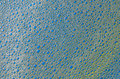 The foam bubbles on blue yellow background texture