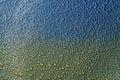 The foam bubbles on blue yellow background texture, Ukrainian flag