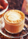 Foam in mocha close up coffe cup on the coffee beans Royalty Free Stock Images