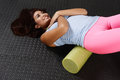 Foam roller woman using a after a workout Stock Images