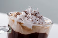 Foam of whipped cream and chocolate chips close-up Viennese coffee glass Royalty Free Stock Photo
