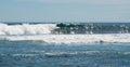 Foamy swell at blue holes beach glistening indian ocean under a clear sky in kalbarri western australia Stock Photos
