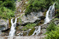 Foamy valley waterfall in bucegi mountains in the carpathians Royalty Free Stock Images