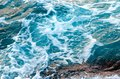 Foamy water waves at the ocean, view from above. Royalty Free Stock Photo
