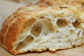 Focaccia bread closeup cutted piece of Stock Photo