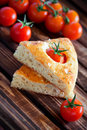 Focaccia with cherry tomatoes rosemary and sea salt selective focus Stock Image