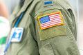 Focus on american flag on usaf uniform of person part united states air force wearing military clothes with pockets and national Royalty Free Stock Photography