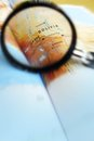 Focus on bolivia south america a photograph showing a magnifying glass focusing the country region of a map also shows the capital Stock Photography